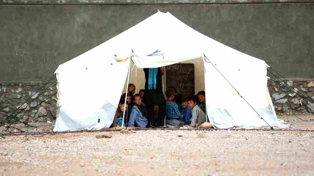 Afghan children attend class in a tent in Bamiyan province, west of Kabul, on June 3. A shortage of buildings is just one of a host of problems the Afghan educational system faces.