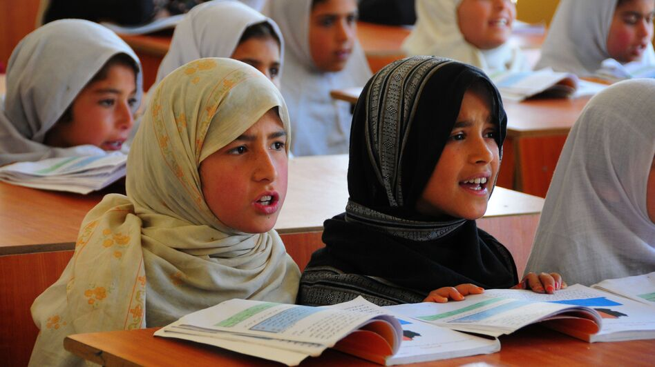 Afghan girls take classes at a refugee school in Afghanistan's Parwan province, on April 3. Under the Taliban, girls were forbidden from receiving an education. Now they account for 40 percent of the country's student enrollment. (Xinhua/Landov)
