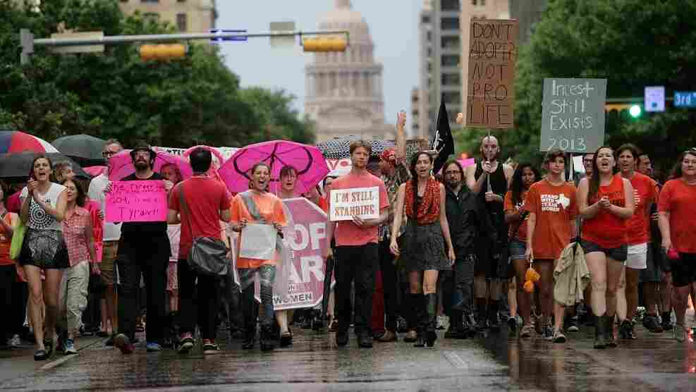 In July, abortion rights advocates marched in Austin, Texas, to protest legislation that could shut down all but five abortion clinics and restrict abortion rights throughout the state.