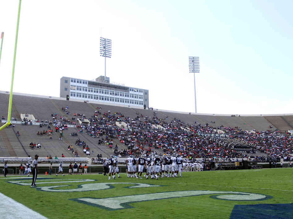 A sparse but enthusiastic crowd watches Jackson State during a scrimmage at homecoming. Jackson State filed suit against Grambling State for lost revenue after a boycott by Grambling players prompted Jackson State's homecoming game to be canceled.