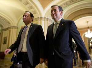 Sen. Mike Lee, R-Utah (left), and Sen. Ted Cruz, R-Texas, walk to the Senate floor on Oct. 16 to vote on a bill to raise the debt ceiling and fund the government.