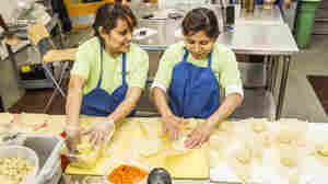 Two employees of Alicia's Tamales los Mayas prepare tamales in the La Cocina industrial kitchen. Alicia Villanueva, the owner, and her team produce 3,000 to 5,000 tamales every week to sell in the Bay Area.