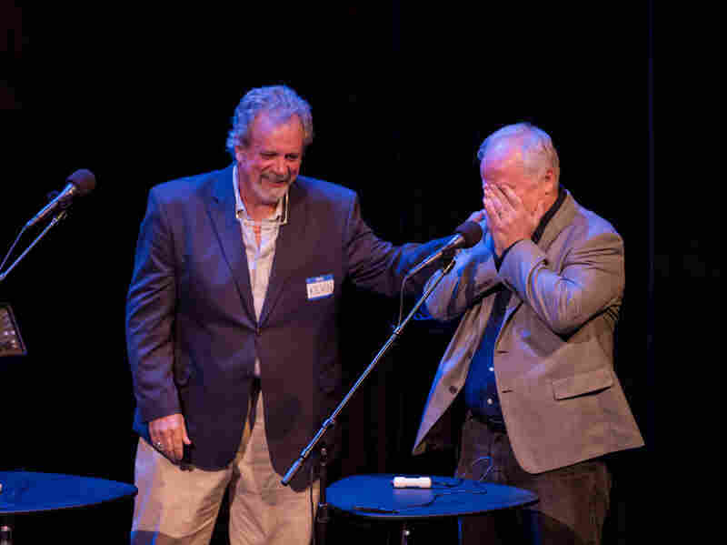 "Kevin Murphy (left) comforts Bill Corbett after Bill incorrectly guessed that ""War With The Mutant Spider Ants"" was a movie title. (It's a Choose Your Own Adventure book, naturally.)"