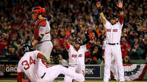 The rout begins: Boston's David Ortiz, No. 34, scores in the first inning of Wednesday's World Series game against St. Louis. Mike Napoli's double brought in three runs, and the Red Sox were on the way to an 8-1 win.
