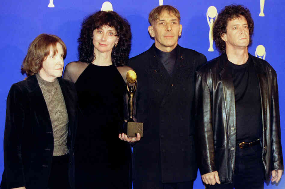 Maureen Tucker, Martha Morrison (wife of Sterling Morrison), John Cale and Lou Reed pose for photographers shortly after The Velvet Underground was inducted into the Rock and Roll Hall of Fame, Jan. 17, 1