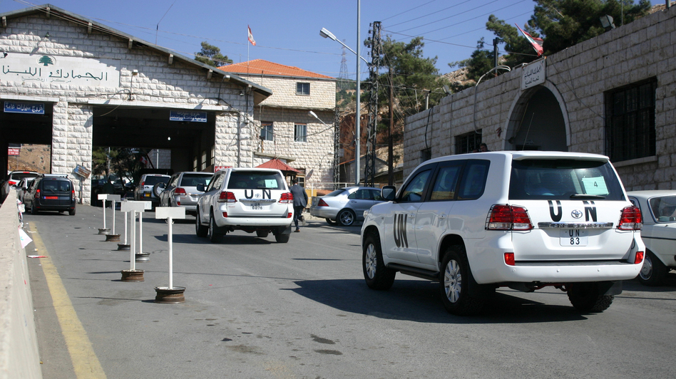 A convoy of United Nations vehicles at the Lebanon-Syria Masnaa border crossing on Oct. 1 as a chemical weapons disarmament team awaited entry into Syria. (AFP/Getty Images)