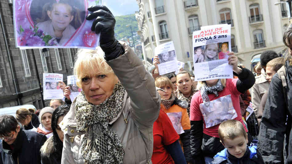 A woman holds up a picture of a 5-year-old girl who disappeared in May in Clermont-Ferrand, in central France. As estimated 250,00 kids go missing each year in Europe, according to the European Union. Many are runaways that are later found, though there are also cases involving small children who are abducted.