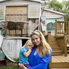 Samantha Langello and her daughter Alanna, 2, stand in front of their flood-damaged house in Fox Beach on Staten Island, N.Y.