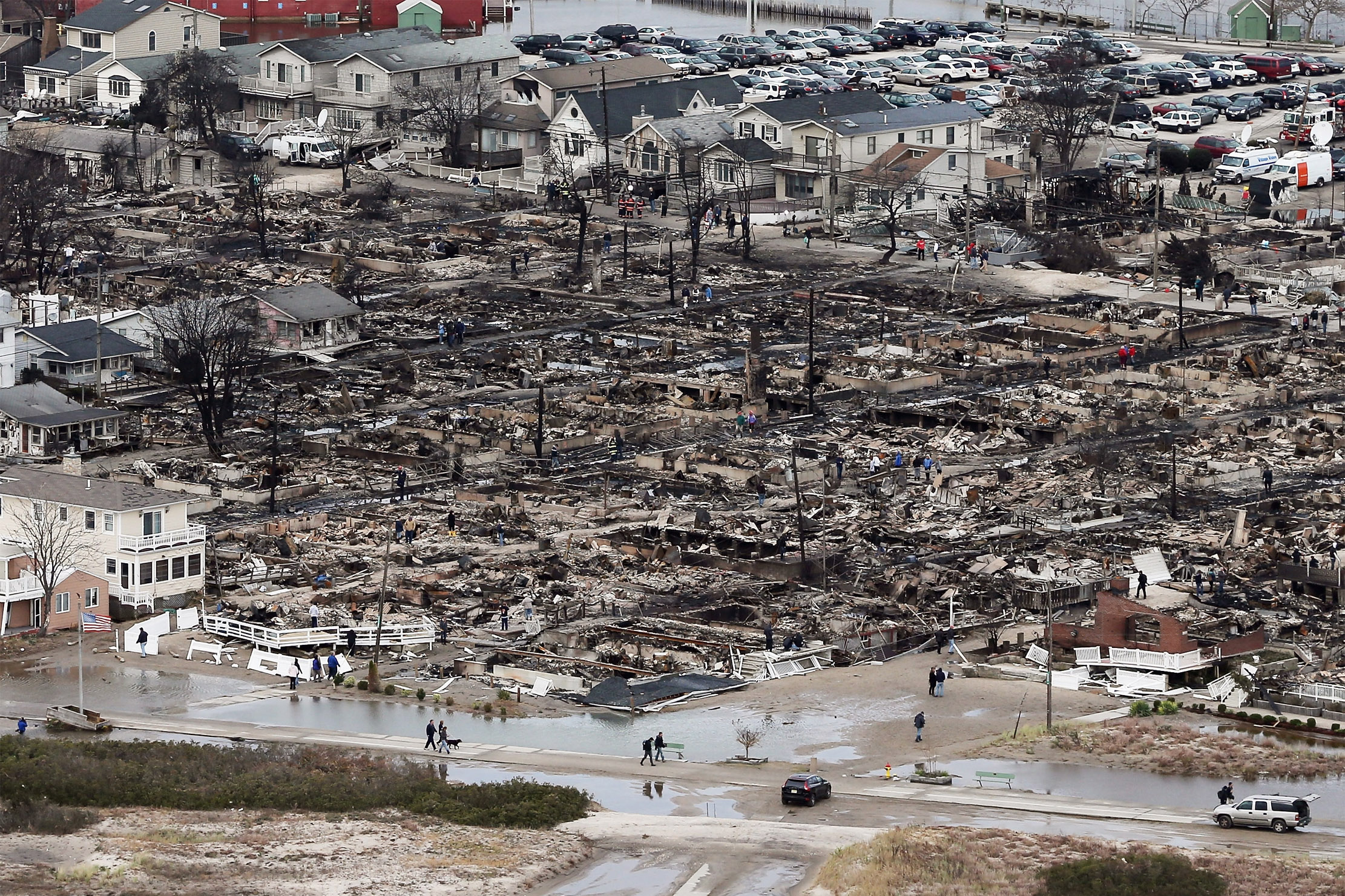 The remains of burned homes are surrounded by water in the Breezy Point neighborhood of Queens, N.Y., Oct. 31, 2012.