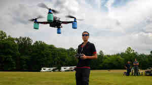 Christopher Vo pilots his aircraft as local drone enthusiasts gather for a Maryland fly-in at an airport in Laytonsville, Md.