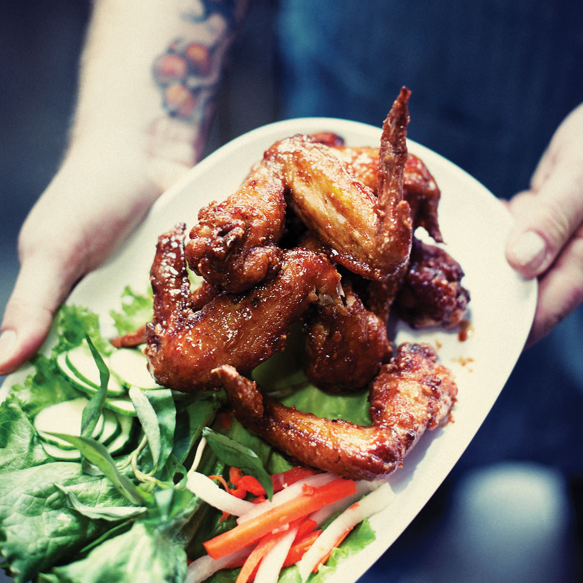 Pok Pok's most popular and addictive dish is Ike's Vietnamese fish sauce wings, according to Karen Brooks, a food critic at Portland Monthly.