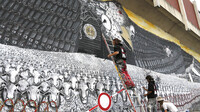 News of U.S. surveillance in Europe has met with distrust and anger; officials are heading to Washington to discuss matters next week. Here, members of an artists' group paint a mural called