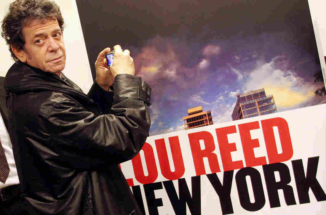 Musician Lou Reed, for decades a rock icon, died Sunday at age 71. In 2006, he took a picture of an ad for his own photo exhibit in Naples.