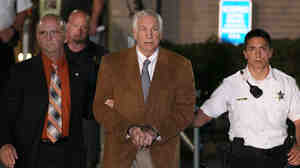 Former Penn State assistant football coach Jerry Sandusky leaves court in handcuffs after being convicted in his child sex abuse trial on June 22, 2012.