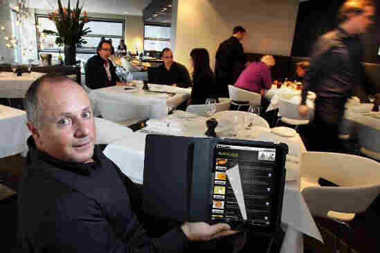 A restaurant customer tries out the Aptito app on a digital menu.