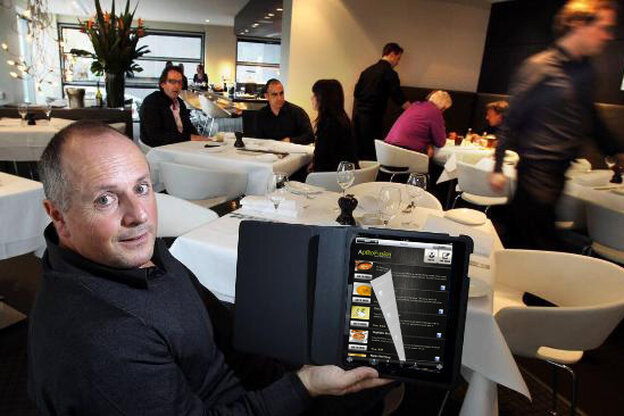 A restaurant customer tries out the Aptito app on a digital menu.