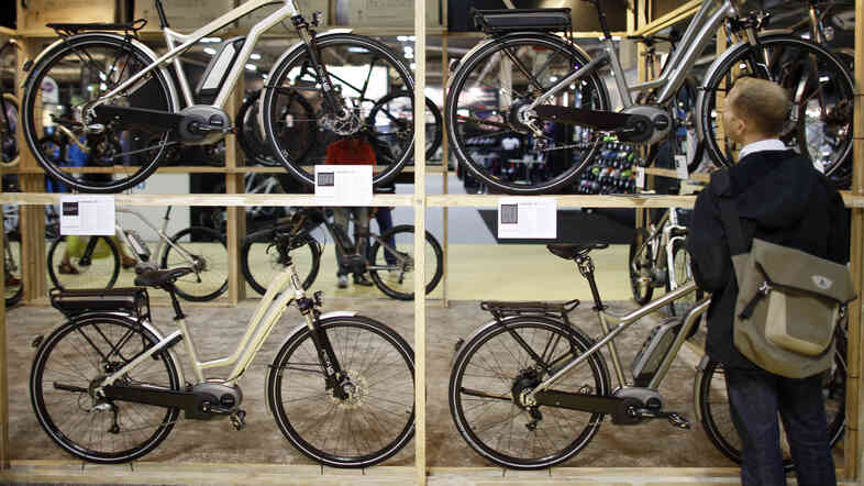Electric bikes made by French company Moustache are displayed during the Cycle Show 2013 in Paris last month.