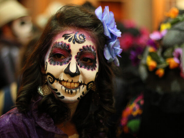 "A woman disguised as ""Catrina"" poses for a photo in Guadalajara, Mexico. La Catrina is the Mexican representation of death, created 100 years ago by Mexican artist Jose Guadalupe Posada."