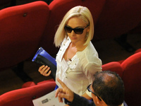 Moldovan Domnica Cemortan, who was spotted with the Costa Concordia's captain, Francesco Schettino, during the spectacular crash of his cruise ship in 2012, during a break in Schettino's trial in July.