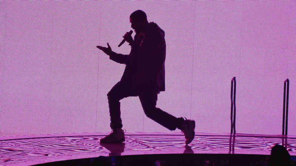 Drake backlit at the Barclays Center in Brooklyn on Monday night.