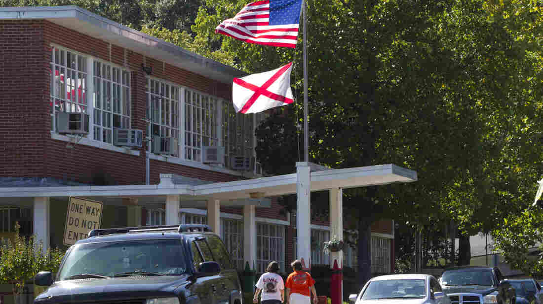 Parents arrive to pick up their children from a school in Montgomery, Ala. After a tough immigration law was enacted in 2011, Hispanic students began to disappear from classrooms in the state's public schools.