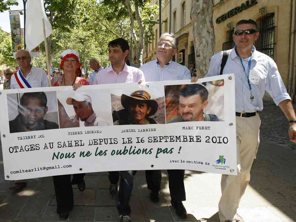 The hostages' families, friends and activists demonstrate in Aix-en-Provence, France, in June