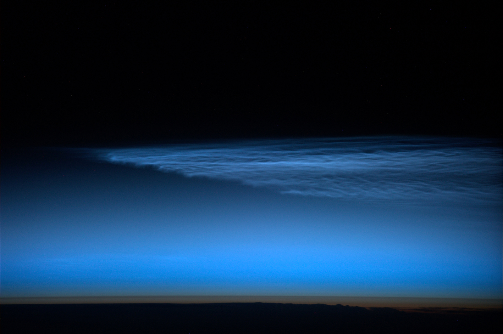 Unexpected noctilucent clouds.