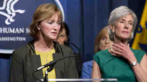 "Health and Human Services Secretary Kathleen Sebelius, (who we're sure was not intentionally making the ""choke"" sign) and Marilyn Tavenner, head of the HHS agency that oversaw the Obamacare website project."