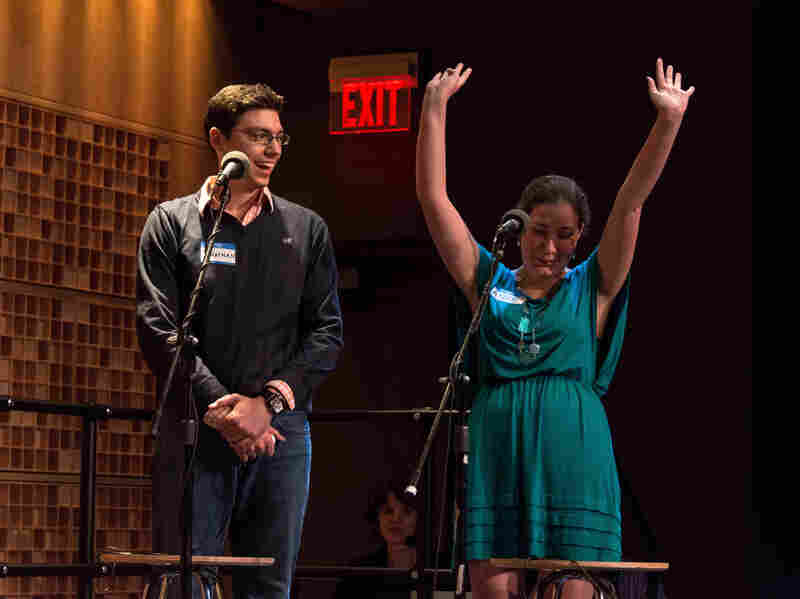 """Contestants Anne Holsinger (right) and Jonathan Bettle correctly answer questions in the game """"Whee!"""""""