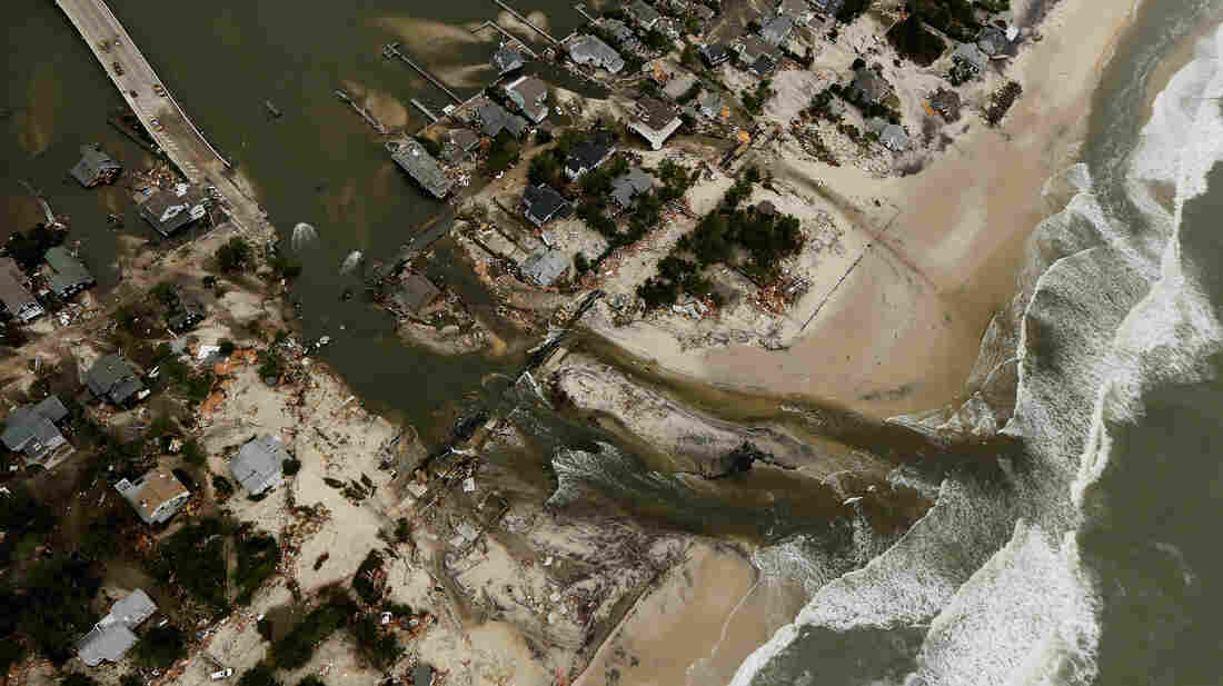 One Year Ago: Homes in Mantoloking, N.J., sit in ruin at the end of a bridge that was wrecked by flooding from Superstorm Sandy.