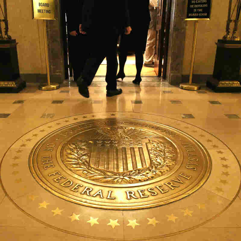 Citing continued signs of weakness, the Federal Reserve said it will keep aiming for low interest rates.