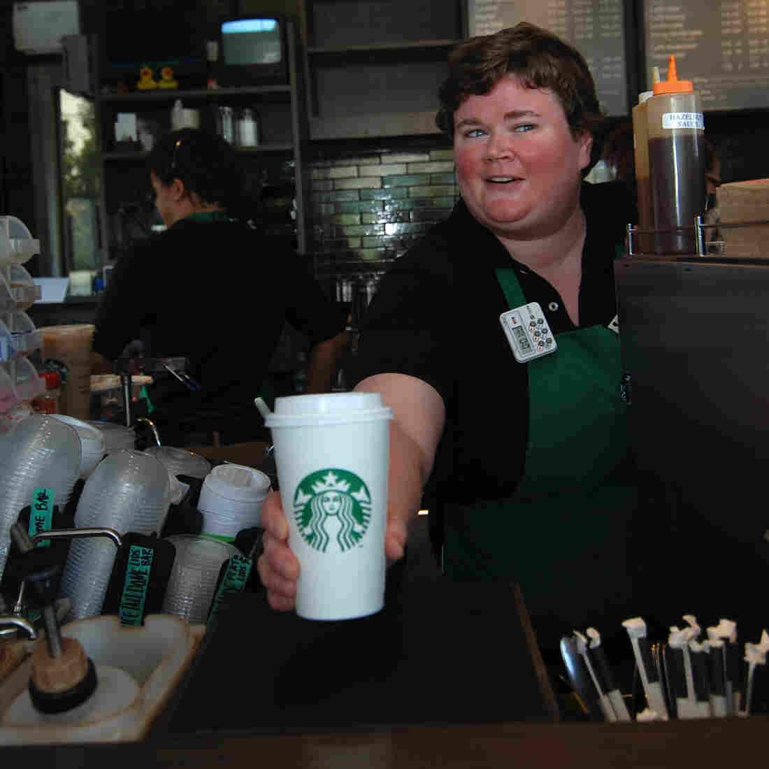 Lisa McNally, serving coffee.