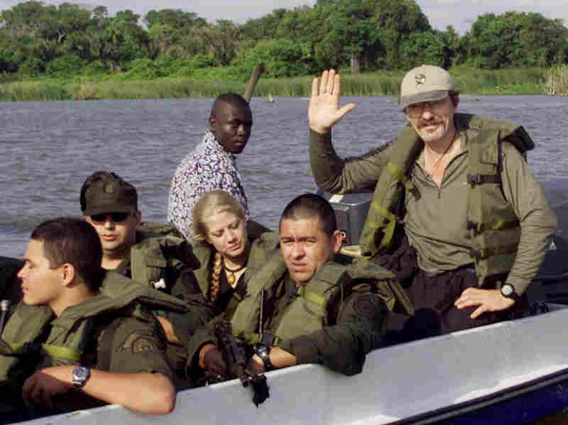 Pelton waves after he was freed from captors in Colombia in 2003. Pelton, who has been traveling to war zones for the past two decades, now wants to find Kony.
