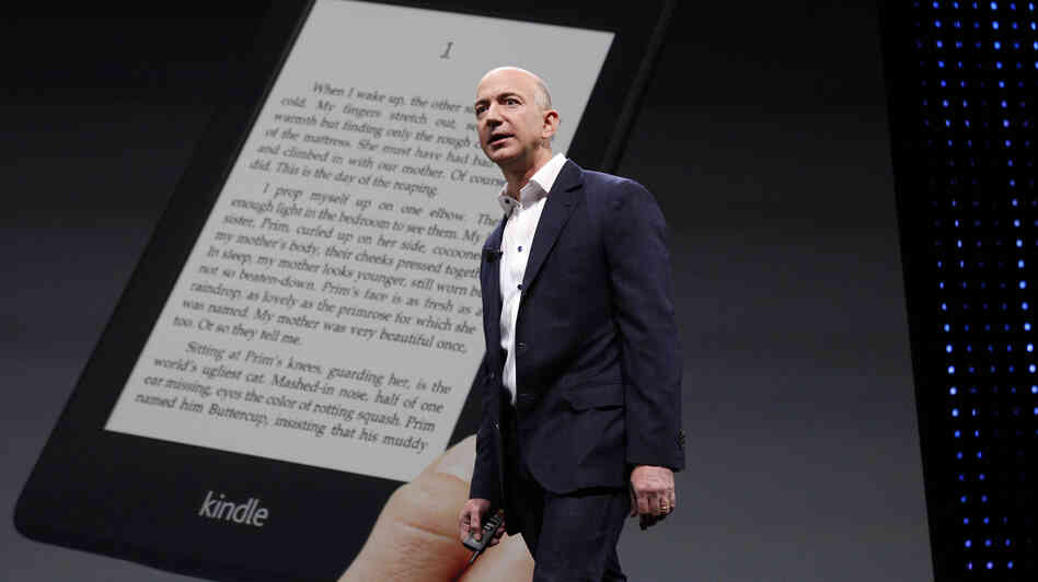 Amazon CEO Jeff Bezos unveils new Kindle reading devices during a 2012 news conference.