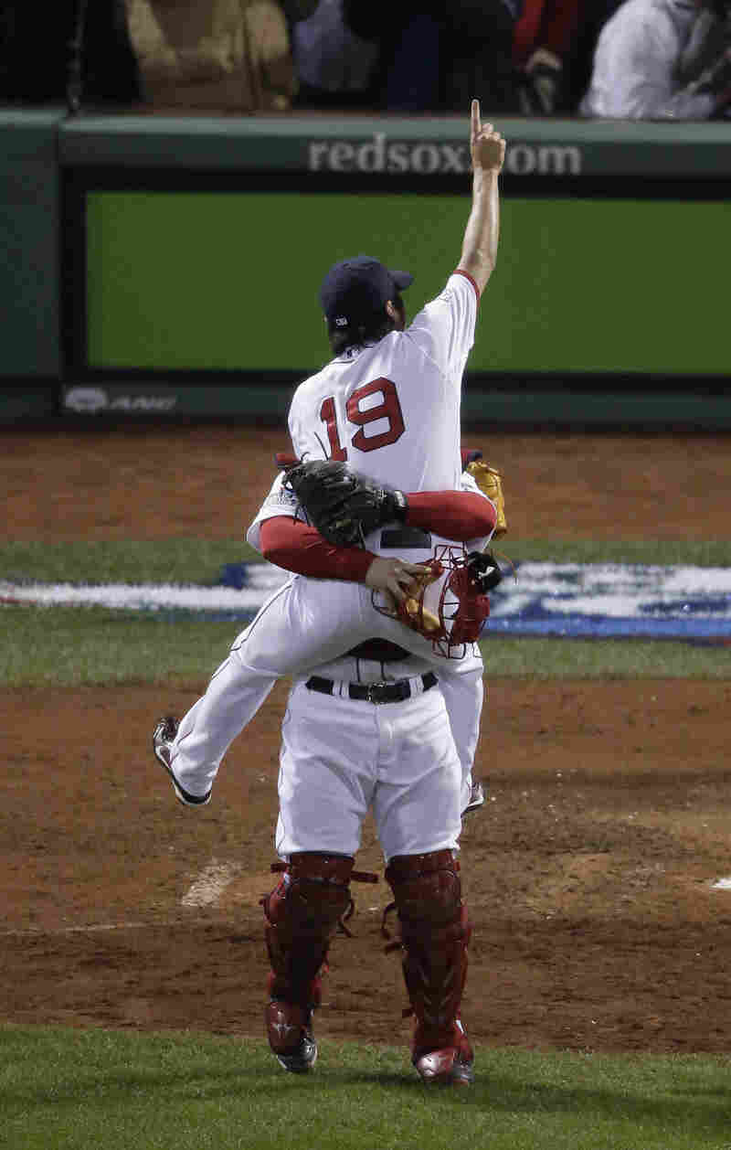 Boston Red Sox relief pitcher Koji Uehara (19) and catcher David Ross celebrate after Boston defeated the St. Louis Cardinals in Game 6 of World Series Wednesday in Boston.