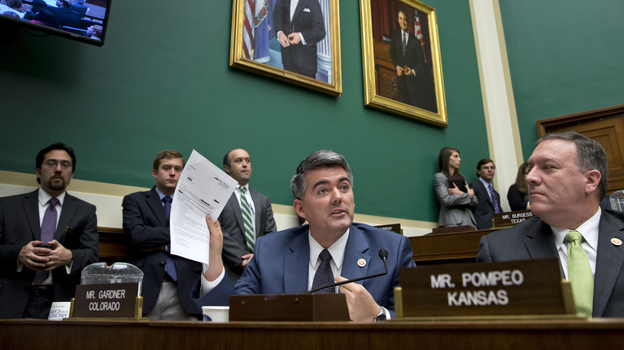 One person who got a letter canceling his health insurance was Rep. Cory Gardner, R-Colo. He holds up the letter during a congressional hearing Wednesday on insurance problems. He says his family chose to buy private insurance rather than use the congressional plan. (AP)