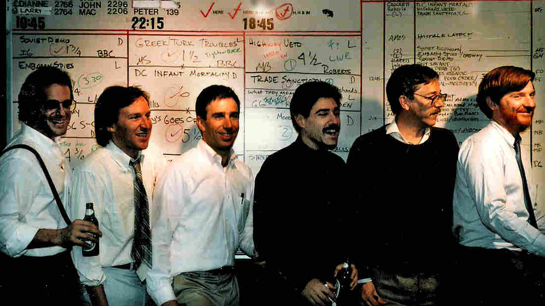All Things Considered Producers (l-r) Peter Breslow, Art Silverman, Richard L. Harris, Maury Schlesinger, Christopher Koch and Neal Conan line up in front of 1986's take on an editorial board.
