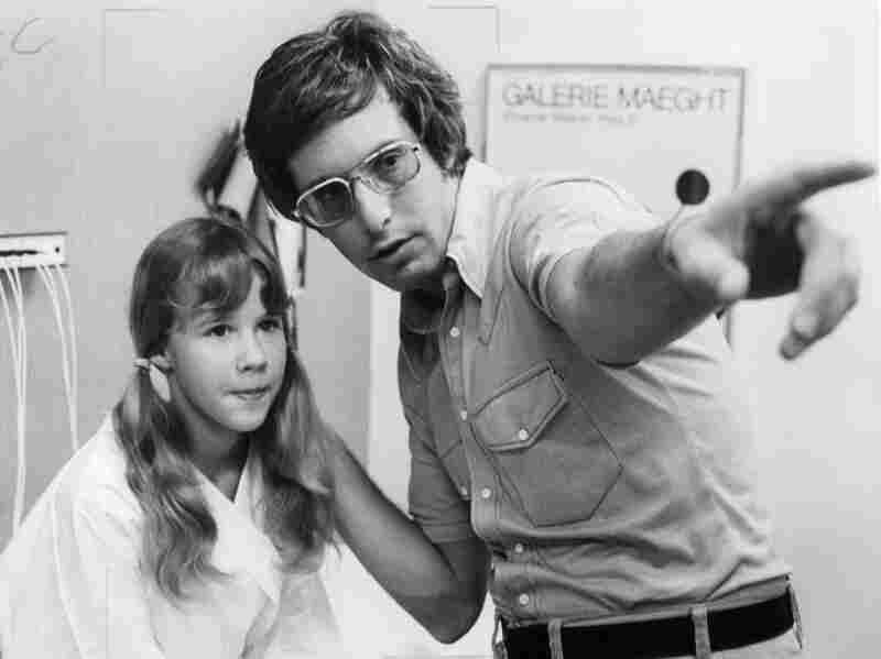 Director William Friedkin, shown here with Blair during shooting, says the film is more about questions of faith than it is about horror.
