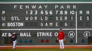 For Game 6, the World Series returns to Boston's Fenway Park, where the home team hasn't clinched a championship since 1918. Here, Red Sox players warm up in front of the Green Monster.