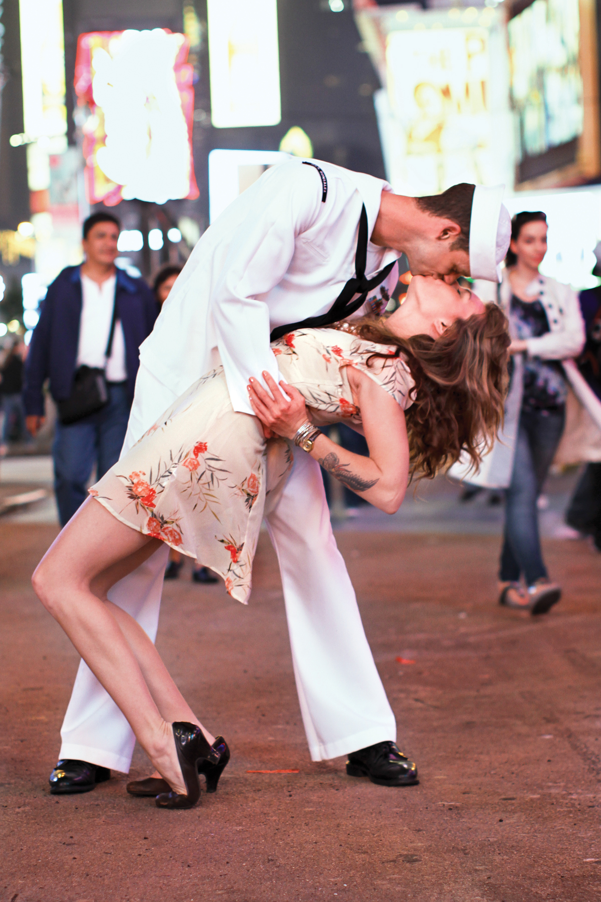 Lovers re-create an iconic kiss in Times Square.