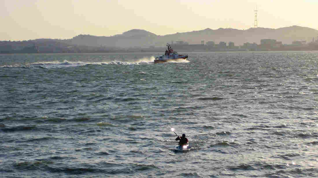 Stephen Linaweaver kayaks home across the San Francisco Bay.