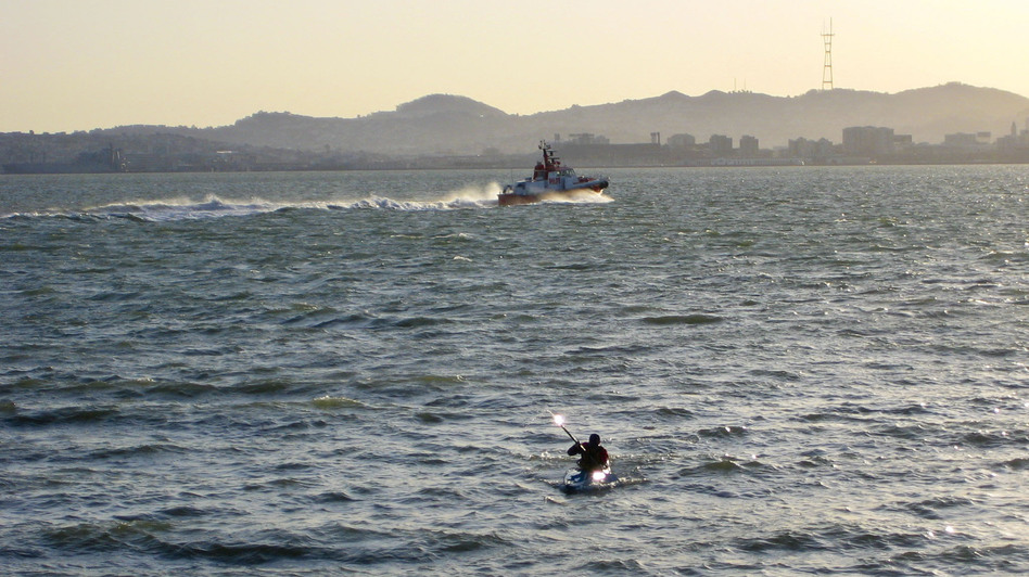 Stephen Linaweaver kayaks home across the San Francisco Bay.