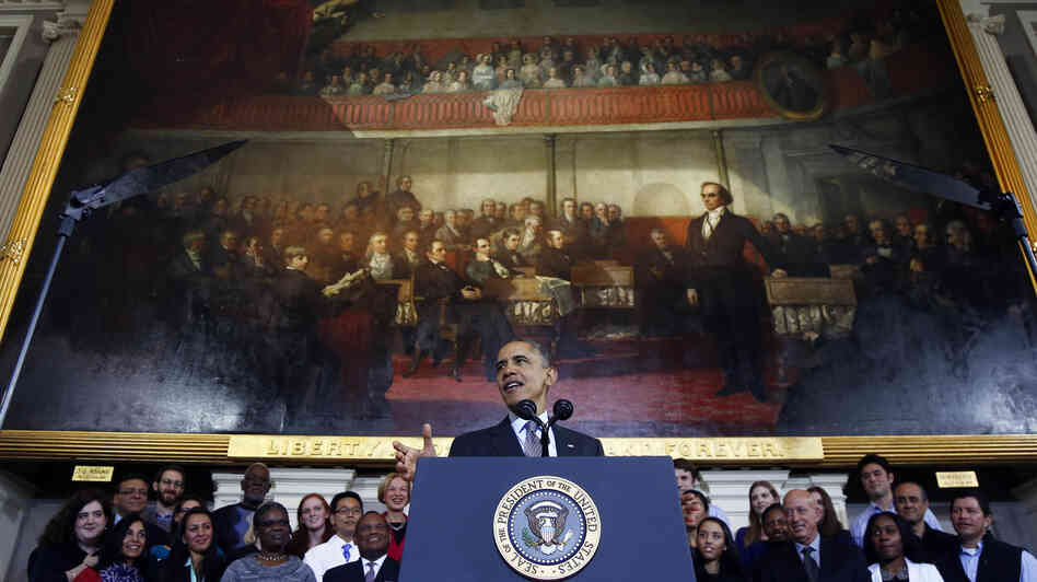President Obama talks up the Affordable Care Act at Boston's historic Faneuil Hall on Wednesday.