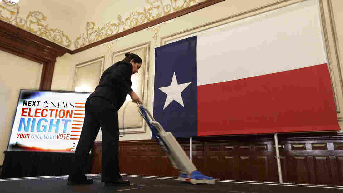 Marta Rangel Medel vacuums the stage in preparation for the Texas Democratic Party 2012 election watch party in Austin. The state's controversial voter ID law is unexpectedly hindering women at the polls.
