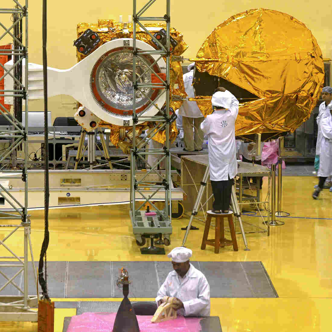 Scientists and engineers work on the Mars Orbiter at the Indian Space Research Organisation's satellite center in Bangalore, India, on Sept. 11. The spacecraft is scheduled to be launched sometime in the next three weeks.