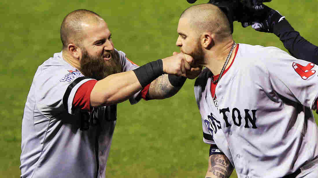 Hey man, that's sensitive: Mike Napoli of the Boston Red Sox pulls teammate Jonny Gomes' beard after hitting a