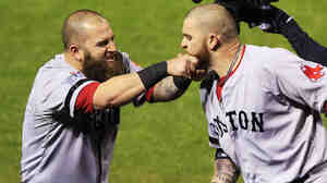 Hey man, that's sensitive: Mike Napoli of the Boston Red Sox pulls teammate Jonny Gomes' beard after hitting a three-run homer in Game 4 of the 2013 World Series in St. Louis.