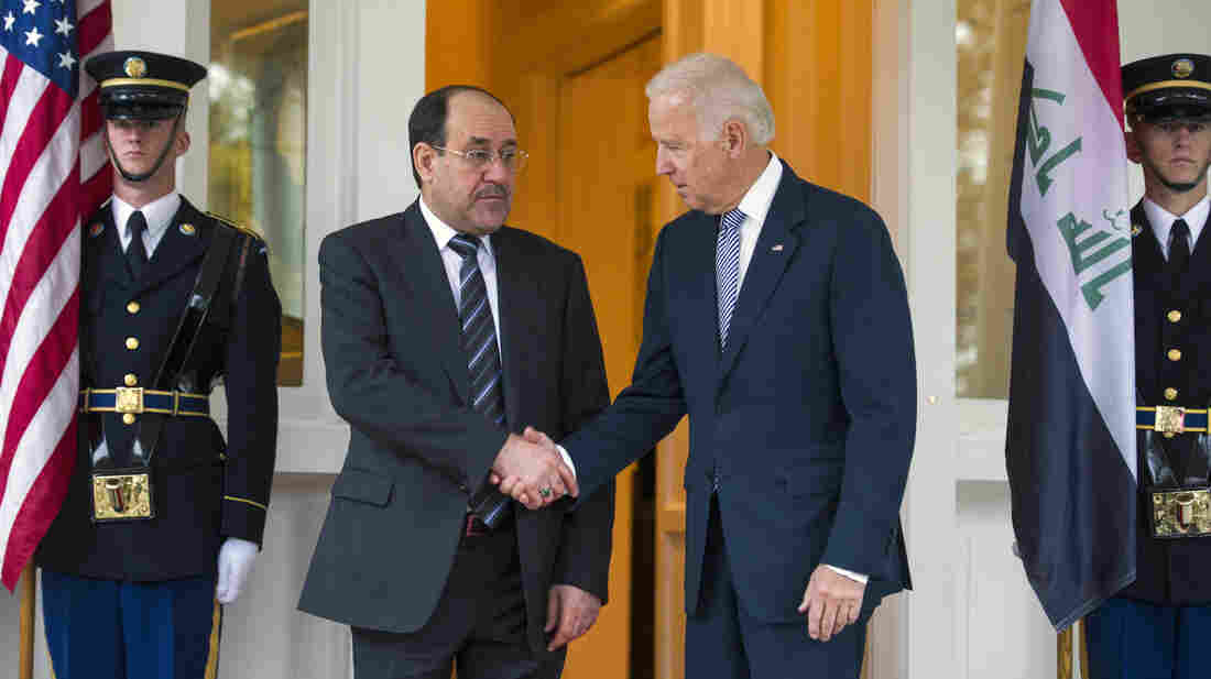Iraqi Prime Minister Nouri al-Maliki is welcomed by Vice President Biden in Washington on Wednesday. Maliki is asking for U.S. military hardware to fight radical groups behind a recent surge in violence in Iraq.