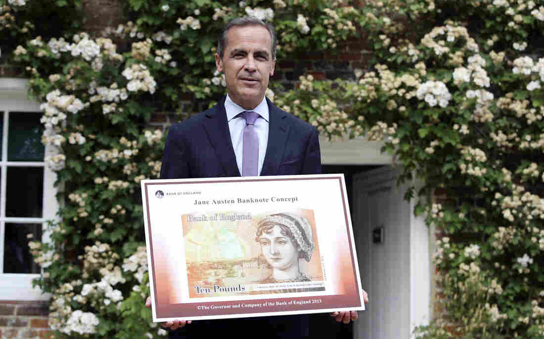 The governor of the Bank of England, Mark Carney, displays the concept design for the new 10-pound banknote featuring author Jane Austen.