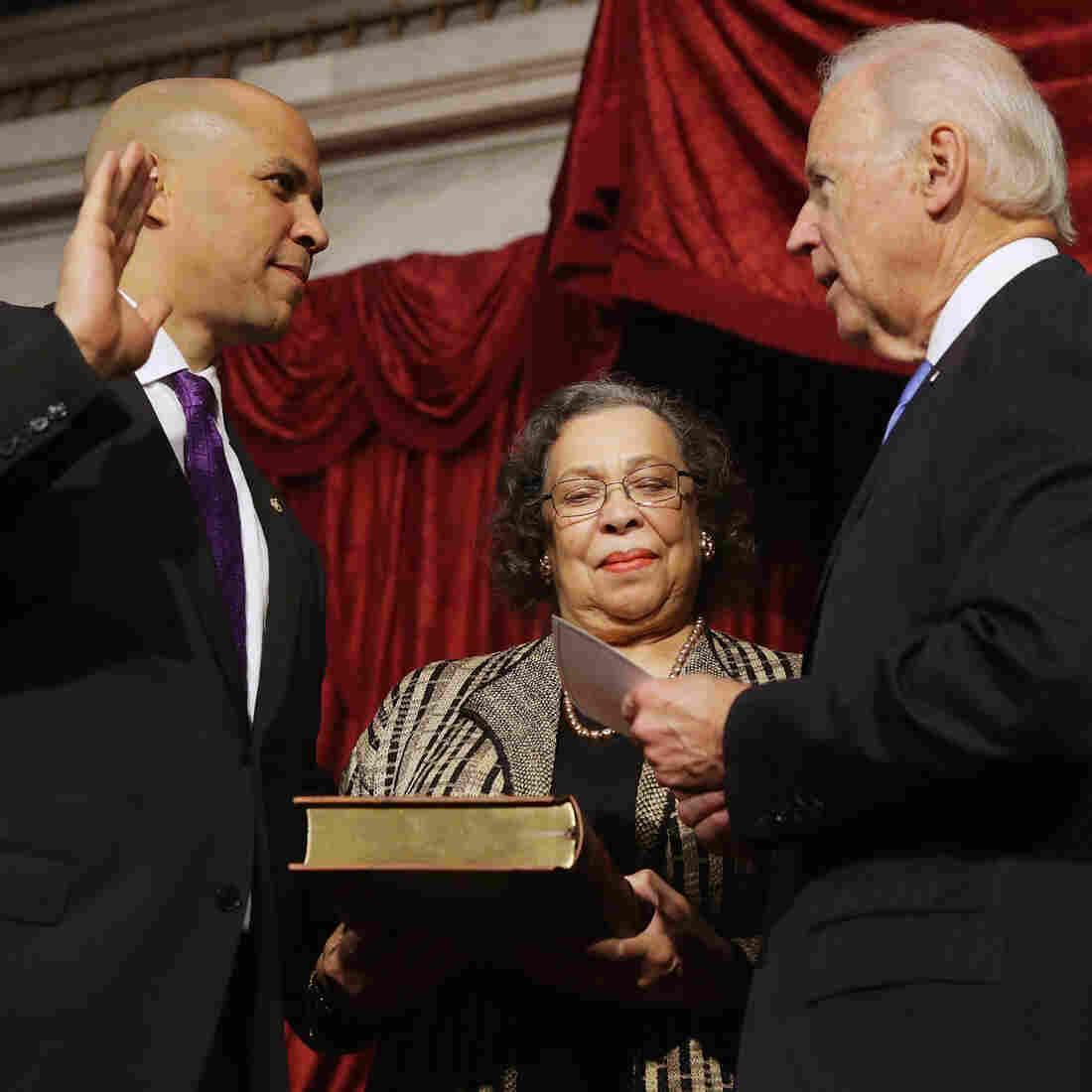 Vice President Joe Biden swears in Sen. Cory Booker (D-NJ) as his mother, Carolyn, holds a Bible on Thursday.